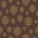 Seamless pattern with golden abstract trees on a dark coffee brown background stock illustration