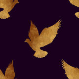 Seamless pattern with golden birds. Stock Images