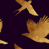 Seamless pattern with golden birds. Stock Photos