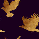 Seamless pattern with golden birds. Royalty Free Stock Photos