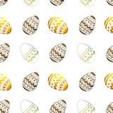 Seamless pattern with golden, blue and black pearly Easter eggs on white background Stock Photography