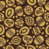 Golden Easter eggs isolated on brown background. Gold Easter Eggs decorated with flowers. Seamless pattern. Seamless pattern of golden Easter eggs isolated on royalty free illustration