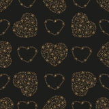 Seamless pattern with golden foil hearts Stock Photography