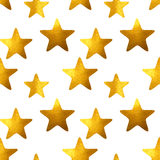 Seamless pattern with golden hand-painted stars on white background Stock Photos