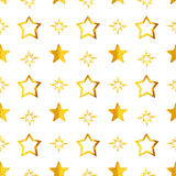 Seamless pattern with golden hand-painted stars on white background Stock Images
