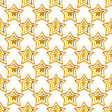 Seamless pattern with golden hand-painted stars on white background Royalty Free Stock Images