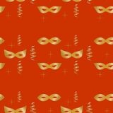 Seamless pattern of golden masks, streamers and stars closeup Stock Image