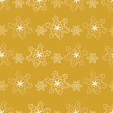Seamless pattern of golden snowflakes. Festive seamless pattern of snowflakes in shades of gold Stock Images