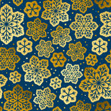 Seamless pattern with golden snowflakes. Ornate Royalty Free Stock Photos