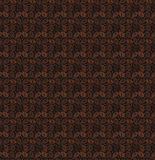 Seamless pattern of grains of coffee on a dark background. Royalty Free Stock Photos