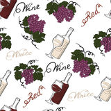 Seamless pattern with grapes and wine bottles. Stock Image