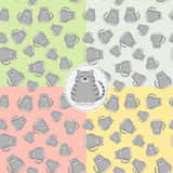 Seamless pattern with a gray cat and sausages. Four seamless patterns with a gray cat and sausages on different backgrounds Royalty Free Stock Photos