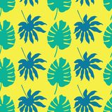 Vector seamless pattern background with green and blue tropical leaves on neon yellow background royalty free illustration
