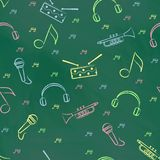 Seamless pattern green chalk board with colorful children's chalk drawings. Hand-drawn style. Seamless vector wallpaper with the image of  drum, microphone Royalty Free Stock Photography