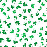 Seamless pattern with green clover Stock Photos