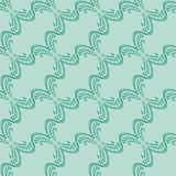 Seamless pattern of green decorative lines on a mint background. vector illustration