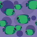 Seamless pattern - green fish. More green fish swimming in blue sea Royalty Free Stock Photos