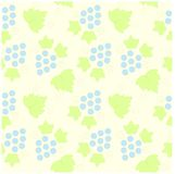 Seamless pattern green grape leaves and blue fruits Stock Photos