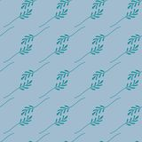 Seamless pattern of green leaves on a blue background. Vector file. royalty free illustration