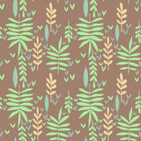 Seamless pattern with green leaves. Hand-drawn seamless pattern with leaves on brown background, decorative floral texture Stock Photos