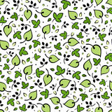 Seamless pattern with green leaves. Vector illustration. Stock Photos