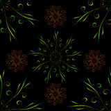 Seamless pattern with green red floral round ornament on black Stock Photo