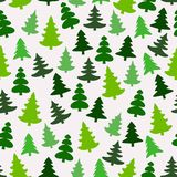 Seamless pattern with green silhouettes of fir-trees and pines. Winter forest background. Scrapbook digital paper. Textile print, page fill. Vector Stock Photography