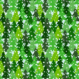Seamless pattern with green silhouettes of fir-trees and pines. Winter forest background with snowfall. Scrapbook digital paper, textile print, page fill Royalty Free Stock Image