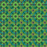 Seamless pattern of  green small geometric shapes Stock Image