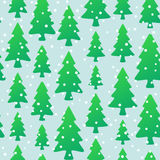 Seamless pattern with green trees and snowflakes. Christmas seamless pattern with fir trees and snowflakes on light background Royalty Free Stock Image