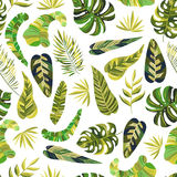 Seamless pattern with green tropical leaves Royalty Free Stock Images