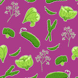Seamless pattern with green vegetables. On purple background Stock Photo
