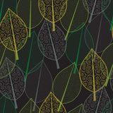 Seamless pattern of green and yellow leaves Stock Photos