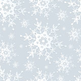Seamless pattern grey with snowflakes. Beautiful seamless pattern with white ornate snowflakes. Winter gray seamless wallpaper for New Year and Christmas Royalty Free Stock Photography