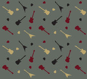 Seamless pattern with guitars on a grey  background Stock Photography