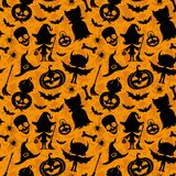 Orange halloween background. Seamless pattern for halloween background with silhouettes Royalty Free Stock Images