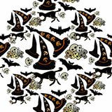 Seamless pattern for halloween bat, witch hat, a cat skull on a Stock Image
