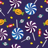 Seamless pattern for halloween. Seamless pattern halloween candy with skull, pumpkin and eyeball on a purple background vector illustration