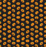 Seamless pattern from Halloween emotional pumpkins Royalty Free Stock Image