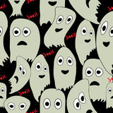 Seamless pattern for Halloween with ghosts. Over black background Royalty Free Stock Images