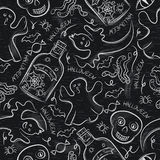Seamless Pattern with Halloween objects on blackboard Stock Photography