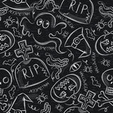 Seamless Pattern with Halloween objects on blackboard Stock Image