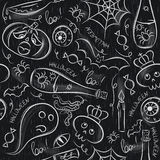 Seamless Pattern with Halloween objects on blackboard Royalty Free Stock Photo
