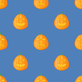 Seamless pattern with halloween pumpkin on blue background. Vector texture Royalty Free Stock Image
