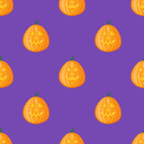 Seamless pattern with halloween pumpkin on purple background. Vector texture Royalty Free Stock Photo