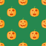 Seamless pattern with halloween pumpkins on green background. Vector texture Stock Photography