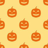 Seamless pattern with halloween pumpkins on yellow background. Vector texture Royalty Free Stock Photos