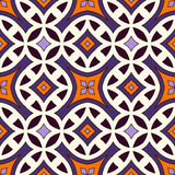 Seamless pattern in Halloween traditional colors. Abstract background with bright ethnic ornaments. Royalty Free Stock Photo
