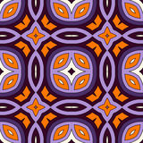 Seamless pattern in Halloween traditional colors. Abstract background with bright ethnic ornaments. Stock Photo