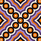 Seamless pattern in Halloween traditional colors. Abstract background with bright geometric ornament. Royalty Free Stock Photo